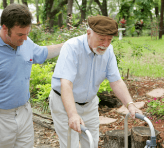 An old man and male caregiver