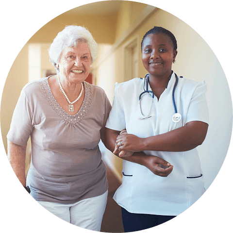Caring female nurse assisting a senior patient to walk