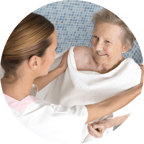 Caregiver assisting elderly women